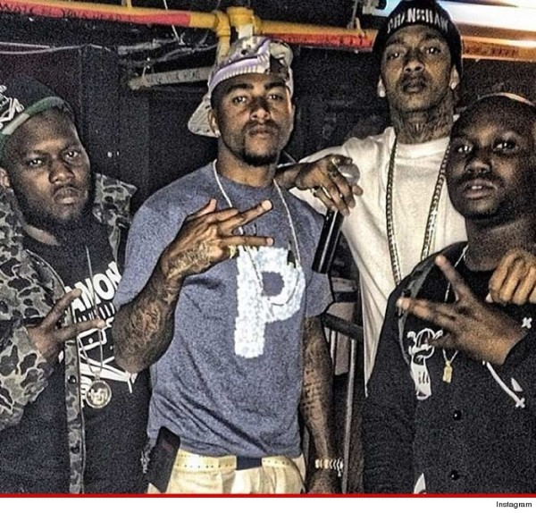 Desean Jackson in a picture with Nipsey Hussle, a known member of the Rollin 60s Crips.
